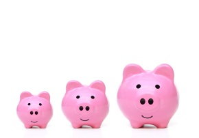 Three sizes of pink piggy bank for saving money